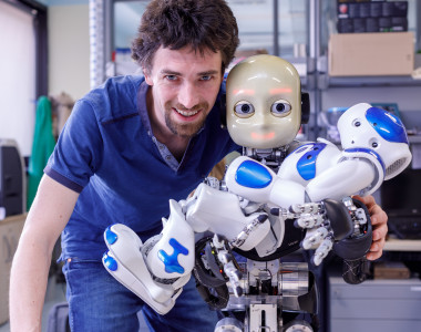 <p>Matej Hoffmann with iCub and Nao humanoid robots. / Duilio Farina, Italian Institute of Technology</p>